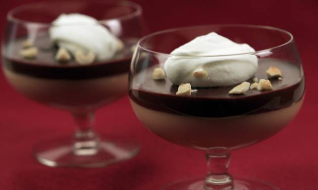 The budino al caramello at Brunos Trattoria in Brea, California, is creamy caramel custard and rich chocolate ganache beautifully layered then topped with a dollop of whipped sour cream and a sprinkling of chopped toasted hazelnuts. (Glenn Koenig/Los Angeles Times/MCT)