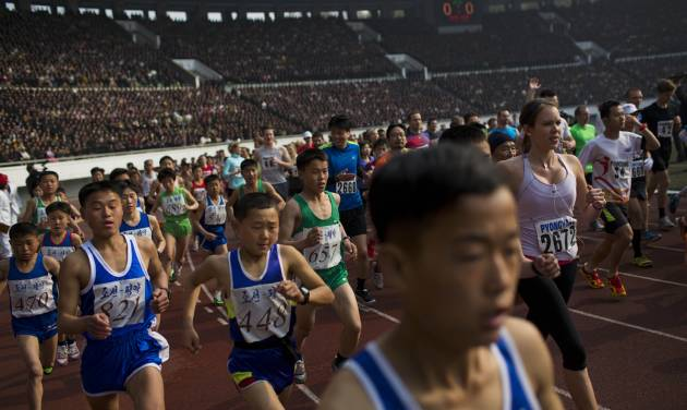 Runners take off from the starting line inside Kim Il Sung Stadium at the beginning of the  Mangyongdae Prize International Marathon in Pyongyang, North Korea on Sunday, April 13, 2014. The annual race, which includes a full marathon, a half marathon, and a 10-kilometer run, was open to foreign tourists for the first time this year. (AP Photo/David Guttenfelder)