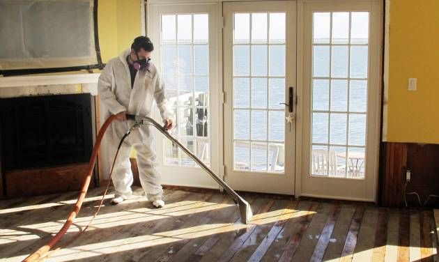 In this Jan. 24, 2013 photo, Victor Pena of Flag Enterprises steam-cleans a floor in a home in Massapequa, N.Y. Homeowners in New York and New Jersey are struggling to combat outbreaks of mold from water-logged homes in the wake of Superstorm Sandy. (AP Photo/Frank Eltman, File)