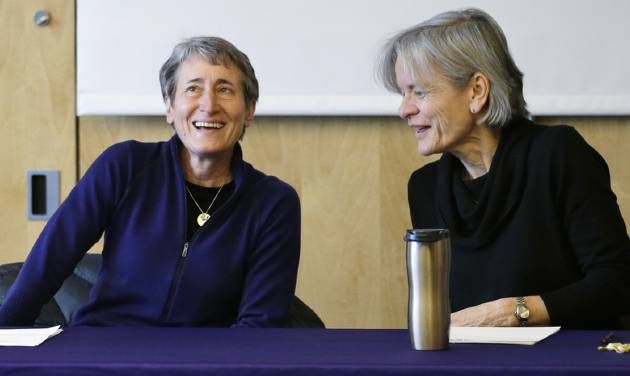 U.S. Interior Secretary Sally Jewell, left, talks with Lisa Graumlich, dean of the College of the Environment, before beginning a roundtable discussion at the University of Washington, Tuesday, Feb. 4, 2014, in Seattle. As part of President Obama's Climate Action Plan to cut carbon pollution, develop domestic clean energy sources and create American jobs, the gathering focused on climate change impacts to the Pacific Northwest. (AP Photo/Elaine Thompson)