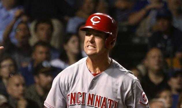 Cincinnati Reds' Ryan Ludwick reacts after striking out to Chicago Cubs starting pitcher Jake Arrieta to end the Reds' half of the seventh inning of a baseball game Tuesday, June 24, 2014, in Chicago. (AP Photo/Charles Rex Arbogast)
