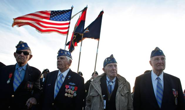 CORRECTS SPELLING FROM BAUMGARTER TO BAUMGARTEN, AND CORRECTS STATES OF RESIDENCE FOR MELINKOFT FROM RHODE ISLAND TO MARYLAND AND FOR McCARTHY FROM MARYLAND TO RHODE ISLAND - From left, World War II veterans of the U.S. 29th Infantry Division, Hal Baumgarten, 90 from Pennsylvania, Steve Melnikoff, 94, from Maryland, Don McCarthy, 90 from Rhode Island, and Morley Piper, 90, from Massachusetts, attend a D-Day commemoration, on Omaha Beach, western France , Friday June 6, 2014. Veterans and Normandy residents are paying tribute to the thousands who gave their lives in the D-Day invasion of Nazi-occupied France 70 years ago. World leaders and dignitaries including President Barack Obama and Queen Elizabeth II will gather to honor the more than 150,000 American, British, Canadian and other Allied D-Day troops who risked and gave their lives to defeat Adolf Hitler's Third Reich. (AP Photo/Thibault Camus)