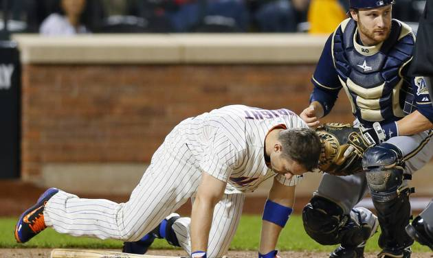New York Mets David Wright (5) is assisted by Milwaukee Brewers catcher Jonathan Lucroy after Wright was hit in the head by a pitch in the third inning of a baseball game against the Milwaukee Brewers at Citi Field in New York, Thursday, Sept. 26, 2013. (AP Photo/Paul J. Bereswill)