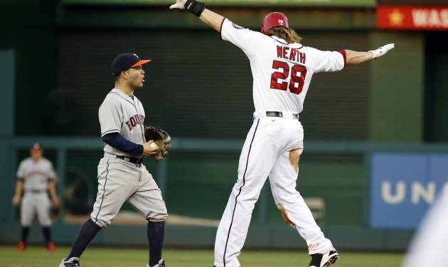 Washington Nationals' Jayson Werth, right, calls himself safe after Houston Astros second baseman Jose Altuve, left, missed the tag on Werth's steal of second base during the third inning of an interleague baseball game at Nationals Park Wednesday, June 18, 2014, in Washington. (AP Photo/Alex Brandon)