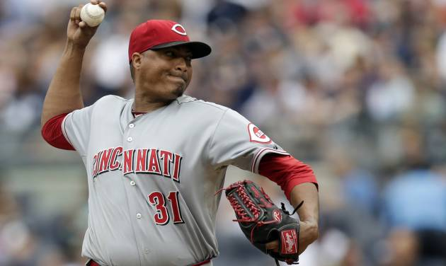 Cincinnati Reds starting pitcher Alfredo Simon throws a pitch to the New York Yankees during the first inning of an MLB baseball game, Saturday, July 19, 2014, at Yankee Stadium in New York. (AP Photo/Julio Cortez)
