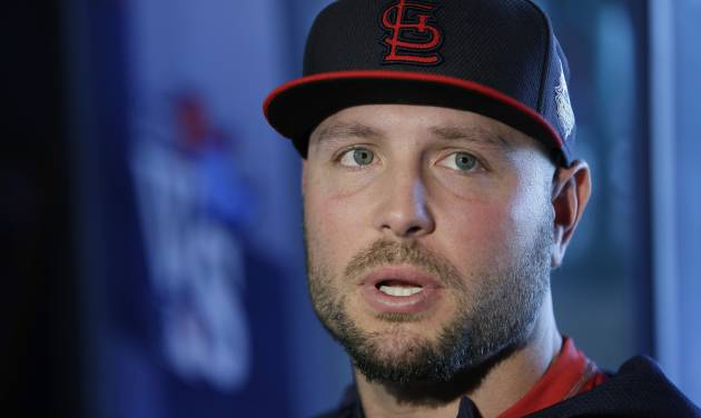 File-This Oct. 22, 2013, file photo shows St. Louis Cardinals' Matt Holliday answering questions during a media availability for Game 1 of baseball's World Series against the Boston Red Sox in Boston. Holliday has been an outspoken critic of players who have used performance-enhancing drugs. When it comes to Jhonny Peralta, his new St. Louis Cardinals teammate, he is willing to forgive and forget.  (AP Photo/Matt Slocum, File)