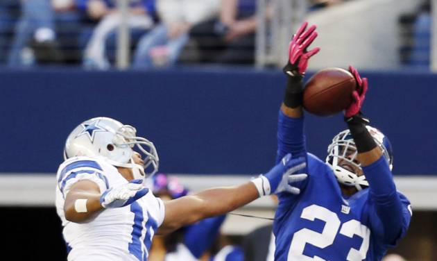 New York Giants cornerback Corey Webster (23) intercepts a pass from Dallas Cowboys quarterback Tony Romo intended for wide receiver Miles Austin (19) during the first half of an NFL football game Sunday, Oct. 28, 2012 in Arlington, Texas. (AP Photo/Sharon Ellman)