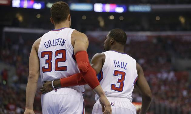 Los Angeles Clippers' Blake Griffin, left, chats with Chris Paul during the first half in Game 5 of a first-round NBA basketball playoff series against the Memphis Grizzlies in Los Angeles, Tuesday, April 30, 2013. (AP Photo/Jae C. Hong)