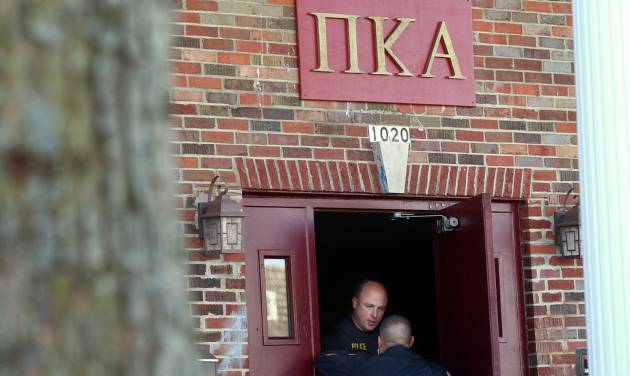 In this Nov. 2, 2012 photo, DeKalb police Sgt. Jason Leverton speaks with an Northern Illinois University police officer in the doorway of the Pi Kappa Alpha house in DeKalb, Ill. where police were investigating the death of NIU freshman David Bogenberger. Nearly two dozen Pi Kappa Alpha members at Northern Illinois University have been charged with hazing-related counts after Bogenberger was found dead at their fraternity house following a night of drinking. (AP Photo/Daily Chronicle, Kyle Bursaw) CHICAGO LOCALS OUT; ROCKFORD REGISTER STAR OUT; MANDATORY CREDIT