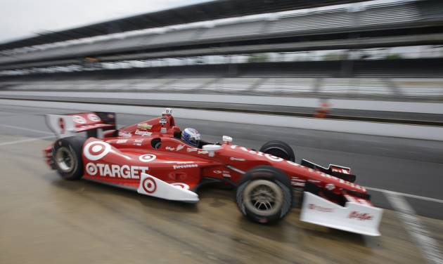 Scott Dixon, of New Zealand, pulls out of the pits during qualifications for the inaugural Grand Prix of Indianapolis IndyCar auto race at the Indianapolis Motor Speedway in Indianapolis, Friday, May 9, 2014. (AP Photo/Darron Cummings)