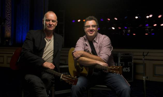"FILE - In this Sept. 20, 2011 file photo, musicians Sting, left, and Vince Gill pose for a portrait at the Hammerstein Ballroom in New York. Sting and Vince will perform together on CMT's ""Crossroads,"" airing Thursday, Nov. 24 at 8 pm EST.(AP Photo/Charles Sykes, file)"