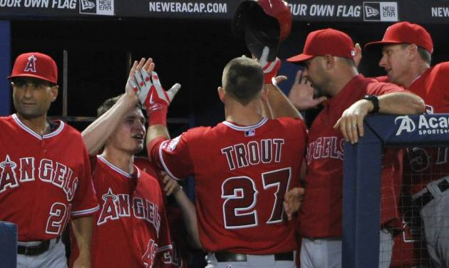 Los Angeles Angels' Mike Trout (27) celebrates with teammates after his home run against the Atlanta Braves during the sixth inning of a baseball game on Saturday, June 14, 2014, in Atlanta. (AP Photo/David Tulis)