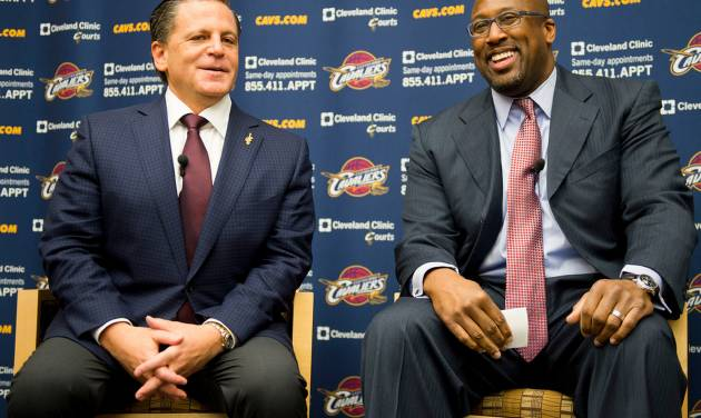 Cleveland Cavaliers owner Dan Gilbert, left, talks with new head coach Mike Brown during a press conference at the team's headquarters introducing Brown on Wednesday, April 24, 2013, in Independence, Ohio. (AP Photo/Jason Miller)