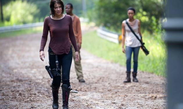 """This undated image released by AMC shows Lauren Cohan as Maggie Greene, left, in a scene from """"The Walking Dead. Cohan says being on the series for three seasons has changed her temperament after being immersed in dark material. (AP Photo/AMC, Gene Page)"""