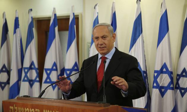 Israel's Prime Minister Benjamin Netanyahu delivers a statement at his office in Jerusalem, Wednesday, Jan. 23, 2013. A weakened Netanyahu scrambled Wednesday to keep his job by extending his hand to a new centrist party that advocates a more earnest push on peacemaking with the Palestinians and whose surprisingly strong showing broadsided him with a stunning election deadlock. (AP Photo/Darren Whiteside, Pool)