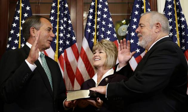 In this Nov. 13, 2012 file photo, House Speaker John Boehner of Ohio, left, performs a mock swearing in for Rep. David Curson, D-Mich., accompanied by his wife Sharon Curson, on Capitol Hill in Washington. Driving from Michigan in his Ford F150 pickup truck, Curson arrived in Washington a week ago. He set up an office last Sunday, was sworn in on Tuesday and by Friday had logged his first votes and given his first floor speech _ one that stretched a bit past the one-minute he'd been allotted. The 64-year-old Democrat has no time to waste. In six weeks, he'll be gone. (AP Photo/Alex Brandon, File)
