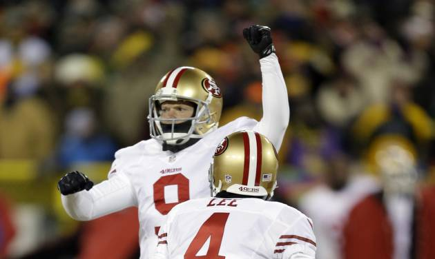 San Francisco 49ers kicker Phil Dawson (9) celebrates after kicking the game-winning field goal during the second half of an NFL wild-card playoff football game, Sunday, Jan. 5, 2014, in Green Bay, Wis. The 49ers won 23-20. (AP Photo/Mike Roemer)