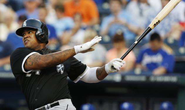 Chicago White Sox's Dayan Viciedo (24) hits a three-run home run off Kansas City Royals relief pitcher Bruce Chen during the third inning of a baseball game at Kauffman Stadium in Kansas City, Mo., Friday, June 21, 2013. (AP Photo/Orlin Wagner)