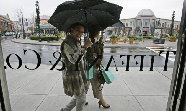 FILE - In this Nov. 7, 2008 file photo, shoppers look in through a window at Tiffany & Co.'s new store at Easton Town Center in Columbus, Ohio. Jewelry retailer Tiffany & Co. said Friday, March 22, 2013, its fourth-quarter net income edged up less than 1 percent, but managed to beat Wall Street predictions. (AP Photo/Kiichiro Sato, File)