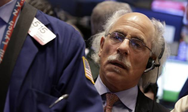 FILE - In this Wednesday, Dec. 18, 2013, file photo, trader Peter Tuchman works on the floor of the New York Stock Exchange.  (AP Photo/Richard Drew, File)
