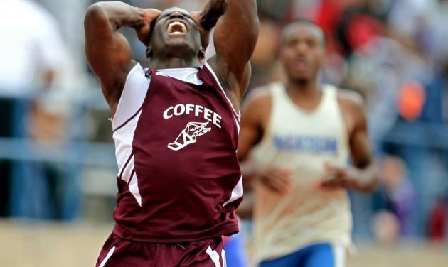 May 12, 2012 - Jefferson, Ga: Coffee's Tyreek Hill reacts in disbelief after he broke the state record in the Class AAAAA 200 meter dash during the Georgia High School Boys Track Championships at Memorial Stadium Saturday afternoon in Jefferson, Ga., May 12, 2012. Hill recorded a time of 20.94 seconds in the 200 meter dash breaking the state record. Hill also was the fastest man with the day's best 100 meter dash time. JASON GETZ / JGETZ@AJC.COM