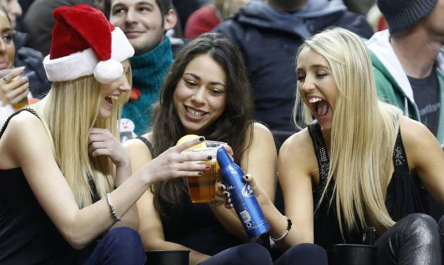 Three fans celebrate during the first quarter of an NBA basketball game between the Portland Trail Blazers and Phoenix Suns in Portland, Ore., Saturday, Dec. 22, 2012. (AP Photo/Don Ryan)