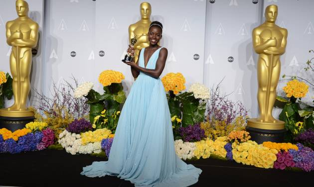 """Lupita Nyong'o poses in the press room with the award for best actress in a supporting role for """"12 Years a Slave"""" during the Oscars at the Dolby Theatre on Sunday, March 2, 2014, in Los Angeles.  (Photo by Jordan Strauss/Invision/AP)"""