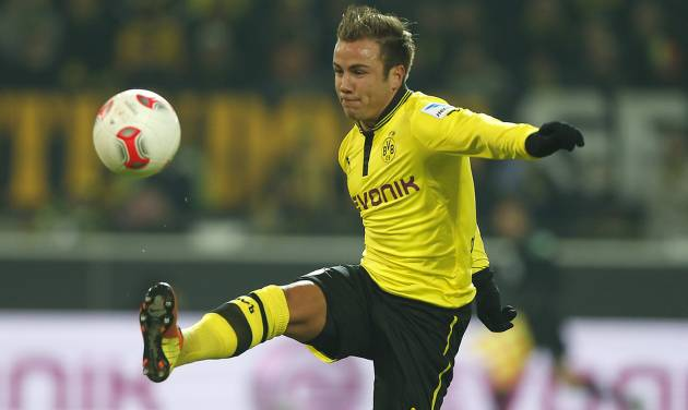 FILE - In this Jan. 25, 2013 file photo Dortmund's Mario Goetze challenges for the ball during the German first division Bundesliga soccer match between  BvB Borussia Dortmund  and 1.FC Nuremberg in Dortmund, Germany. German daily Bild says Goetze has agreed to join Bayern Munich from Bundesliga rival Borussia Dortmund. Bild reports Tuesday, April 23, 2013, that Bayern will pay the 20-year-old Goetze's buy-out clause of around 37 million euros (US dollar 48 million) to sign the Germany star at the end of the season. (AP Photo/Frank Augstein, File)