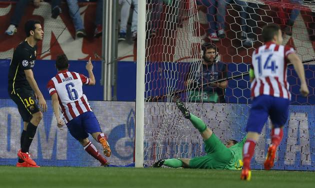 Atletico's Koke celebrates after scoring the opening goal during the Champions League quarterfinal second leg soccer match between Atletico Madrid and FC Barcelona at the Vicente Calderon stadium in Madrid, Spain, Wednesday, April 9, 2014. (AP Photo/Andres Kudacki)