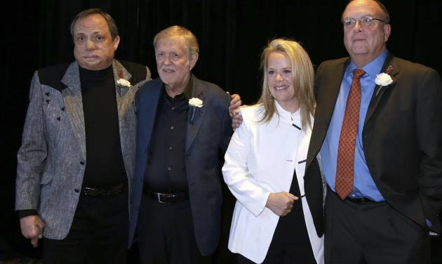 Kim Williams, left; Larry Henley, second from left; Mary Chapin Carpenter, second from right; and Tony Arata, right; pose together before they are inducted into the Nashville Songwriters Hall of Fame on Sunday, Oct. 7, 2012, in Nashville, Tenn. (AP Photo/Mark Humphrey)
