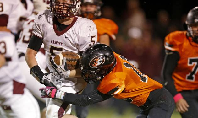 Cashion's Grant Quast fights off Crescent's Devon Bledsoe during a high school football game between Cashion and Crescent in Crescent, Okla., Thursday, Oct. 18, 2012. Photo by Bryan Terry, The Oklahoman