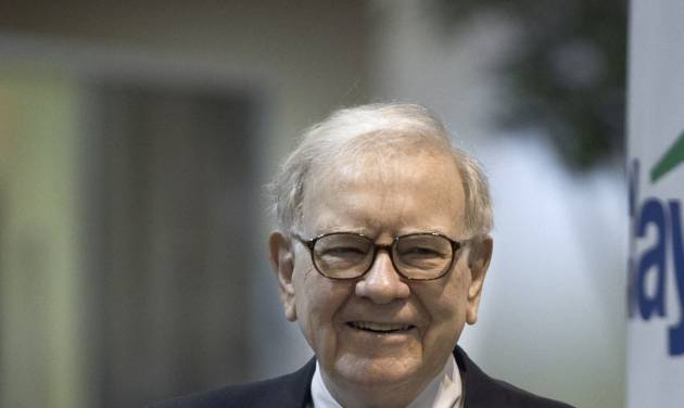 In this May 5, 2012, photo, Warren Buffett, chairman and CEO of Berkshire Hathaway, smiles on the exhibit floor where Berkshire products are showcased, prior to the annual shareholders meeting in Omaha, Neb. Buffett appeared on CNBC Monday morning MAY 7, 2012. (AP Photo/Nati Harnik)