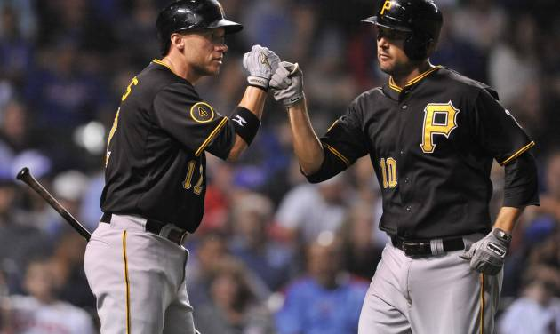 Pittsburgh Pirates' Jordy Mercer (10) celebrates with teammate Clint Barmes (12) after hitting a solo home run during the third inning of a baseball game against the Chicago Cubs in Chicago, Saturday, June 21, 2014. (AP Photo/Paul Beaty)