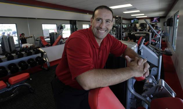 ADDS FULL NAME OF GYM - In this June 14, 2012, photo, manager Rick Limitone poses for a photo at Snap Fitness Rolling Strong Gym, a truck stop gym in Dallas. From trucking companies embracing wellness and weight-loss programs to gyms being installed at truck stops, momentum has picked up in recent years to help those who make their living driving big rigs get into shape. (AP Photo/LM Otero)