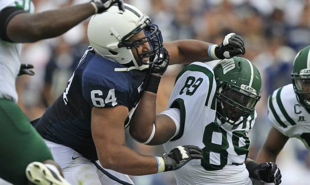 FILE - In this Sept. 1, 2012 file photo, Penn State guard John Urschel (64) battles with Ohio defensive lineman Carl Jones (89) during the first quarter of an NCAA college football game at Beaver Stadium in State College, Pa. The all-Big Ten, third-team AP All-American has a Master's degree in math and was awarded the William V. Campbell Trophy as college football's top scholar-athlete. (AP Photo/Gene J. Puskar, File)