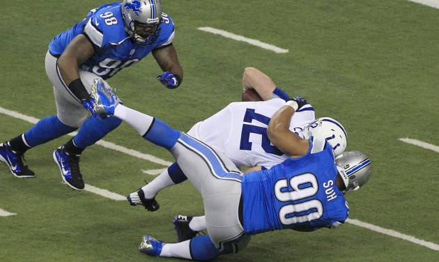 Detroit Lions defensive tackle Ndamukong Suh (90) sacks Indianapolis Colts quarterback Andrew Luck (12) in the first quarter of an NFL football game at Ford Field in Detroit, Sunday, Dec. 2, 2012. (AP Photo/Carlos Osorio)