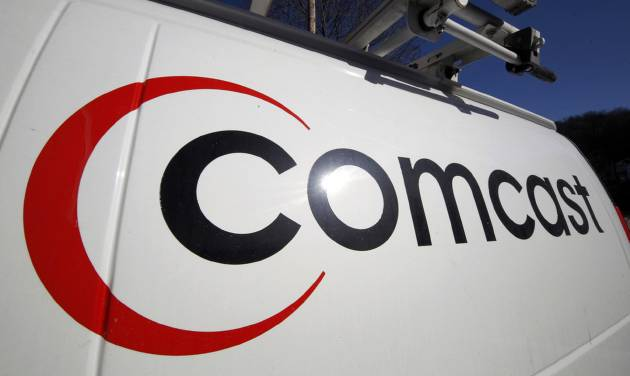 FILE - This Feb. 11, 2011, file photo, shows the Comcast logo on one of the company's vehicles, in Pittsburgh. Comcast plans to sell some cable systems to competitor Charter Communications Inc., to help Comcast's acquisition of Time Warner Cable clear regulatory hurdles, the company announced Monday, April 28, 2014. (AP Photo/Gene J. Puskar, File)