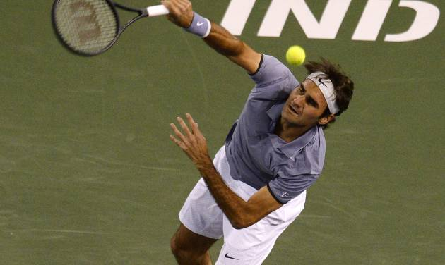 Roger Federer, of Switzerland, serves to Kevin Anderson, of South Africa, during their quarterfinal match at the BNP Paribas Open tennis tournament on Thursday, March 13, 2014, in Indian Wells, Calif. (AP Photo/Mark J. Terrill)