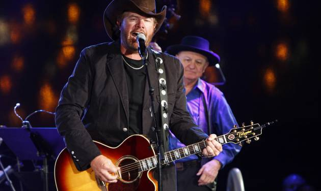 FILE -  In this Oct. 30, 2012, file photo Toby Keith performs at the 60th Annual BMI Country Awards on in Nashville, Tenn. Keith, whose hometown was hit by a massive tornado on Monday, said Tuesday, May 21, 2013, the people of Moore, Okla., are resilient and he has fielded calls about putting together a benefit for tornado victims. (Photo by Wade Payne/Invision/AP, File)