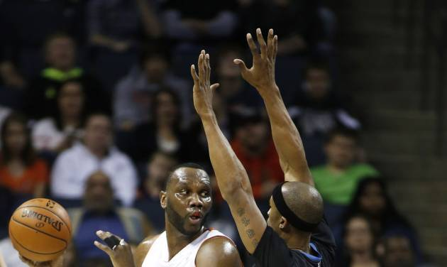 Charlotte Bobcats center Al Jefferson, left, tries to pass around Minnesota Timberwolves forward Dante Cunningham during the first half of an NBA basketball game in Charlotte, N.C., Friday, March 14, 2014. (AP Photo/Nell Redmond)