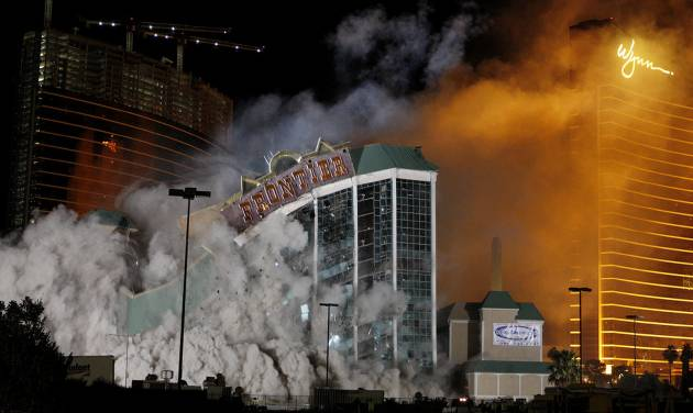 FILE - In this Nov. 13, 2007 file photo The New Frontier Hotel & Casino located on the Las Vegas Strip is imploded. A new resort could soon spring up on the vacant site of the former New Frontier casino, thanks to a partnership between Australian billionaire James Packer and former Wynn Las Vegas President Andrew Pascal. (AP Photo/Isaac Brekken, File)