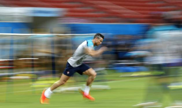 In this photograph taken with a slow shutter, Portugal's Cristiano Ronaldo works out during a training session at the Arena da Amazonia in Manaus, Brazil, Sunday, June 22, 2014. Portugal will play against the United States in group G of the 2014 soccer World Cup on June 22. (AP Photo/Julio Cortez)