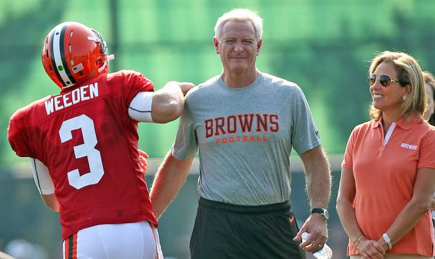 New Cleveland Browns owner Jimmy Haslam III, center, and his wife, Dee, meets Browns rookie quarterback Brandon Weeden at training camp Friday, Aug. 3, 2012 at the Browns training facility in Berea, Ohio. (AP Photo/The Cleveland Plaindealer, Joshua Gunter) NO SALES MANDATORY CREDIT TV OUT NO MAGS NO MAGS, NO TV, ONLINE OUT, MANDATORY CREDIT TV OUT NO MAGS