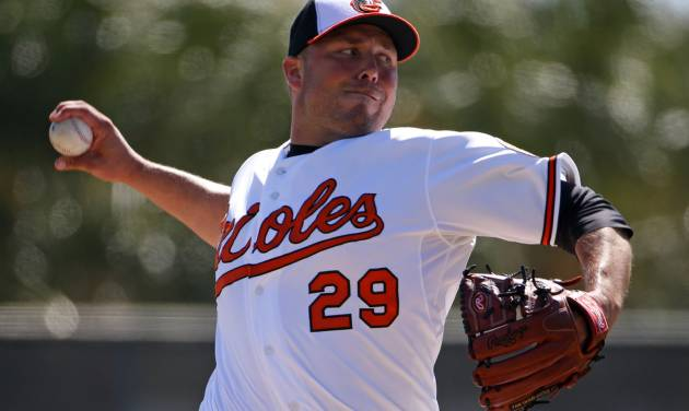 FILE - In this March 8, 2014 file photo, Baltimore Orioles relief pitcher Tommy Hunter throws in the fourth inning of an exhibition spring training baseball game against the Boston Red Sox in Sarasota, Fla. Hunter knows there will come a time this season when he blows a ninth-inning lead to turn a potential victory into a frustrating defeat. The manner in which the right-hander reacts to that disappointment could go a long way toward determining his success as the Baltimore Orioles' new closer. (AP Photo/Gene J. Puskar, File)