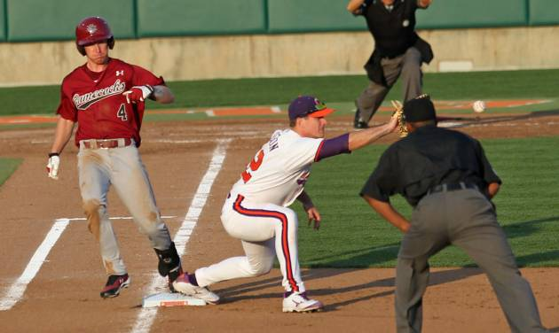 Umpire David Brown, right, watches as South Carolina's Connor Bright, left, tags the bag for a single before Clemson first baseman Jon McGibbon catches the ball during an NCAA college baseball game on Sunday, March 2, 2014 in Clemson, S.C. (AP Photo/Anderson Independent-Mail, Mark Crammer) GREENVILLE NEWS OUT  SENECA JOURNAL OUT