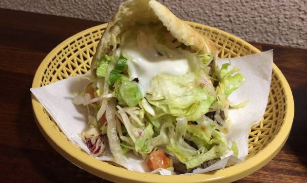 This May 2014 photo shows shawarma _ grilled meat in pita with lettuce, tomato and a tahini sauce _ at the Shawarma Grill House in Copenhagen. The eatery has been serving spectacular Middle Eastern comfort food to Danes and tourists for 30 years. (AP Photo/Amir Bibawy)