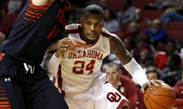 Oklahoma's Romero Osby (24) goes under Texas Tech's Dejan Kravic (11) during an NCAA college basketball game between the University of Oklahoma and Texas Tech University at Lloyd Noble Center in Norman, Okla., Wednesday, Jan. 16, 2013. Photo by Bryan Terry, The Oklahoman