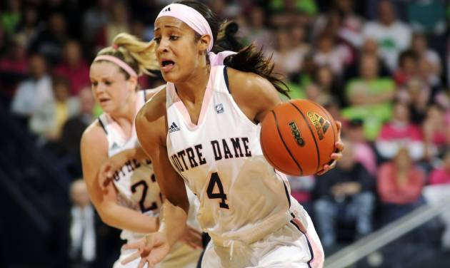 Notre Dame guard Skylar Diggins (4) dribbles upcourt against West Virginia during the first half of an NCAA college basketball game, Sunday, Feb. 12, 2012, in South Bend, Ind. (AP Photo/Joe Raymond)