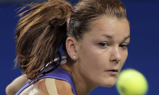 Agnieszka Radwanska of Poland returns a shot to Angelique Kerber of Germany during their semifinal match at the Japan Pan Pacific Open tennis tournament in Tokyo, Friday, Sept. 28, 2012. Radwanska won 6-1, 6-1. (AP Photo/Itsuo Inouye)