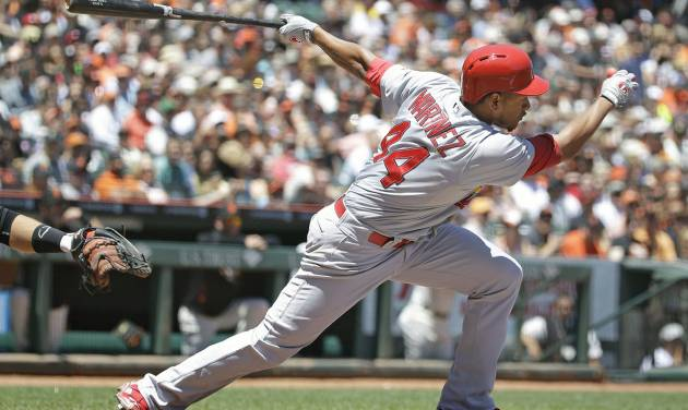 St. Louis Cardinals' Carlos Martinez hits a two-RBI single off San Francisco Giants starting pitcher Madison Bumgarner in the fourth inning of a baseball game on Thursday, July 3, 2014, in San Francisco. (AP Photo/Eric Risberg)